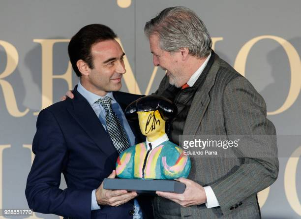 Bullfighter Enrique Ponce and Minister of Education Inigo Mendez de Vigo attend the 'Commodore awards' at Commodore Space on March 7 2018 in Madrid...