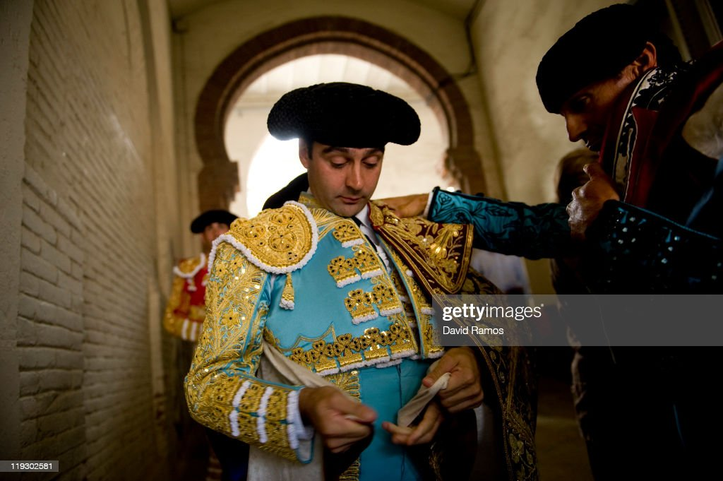 Bullfighter Enrique Ponce (C) from Spain dresses up helped by his assistants before the third bullfight of the 2011 season at the Monumental bullring on July 17, 2011 in Barcelona, Spain. Bull fighting will cease as of January 1, 2012 at the Monumental bullring since the parliament of Catalonia voted to ban bullfighting.