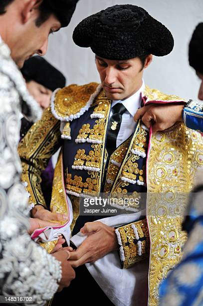 Bullfighter is helped getting dressed before entering the bullring for a bullfight on the fourth day of the San Fermin runningofthebulls on July 10...