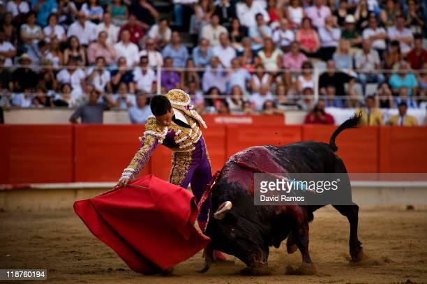 Bullfighter Jose Maria Manzanares performs during the second bullfight of the 2011 season at the Monumental bullring on July 10 2011 in Barcelona...