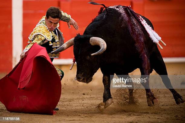 Bullfighter Julian Lope 'El Juli' of Spain performs during the second bullfight of the 2011 season at the Monumental bullring on July 10 2011 in...
