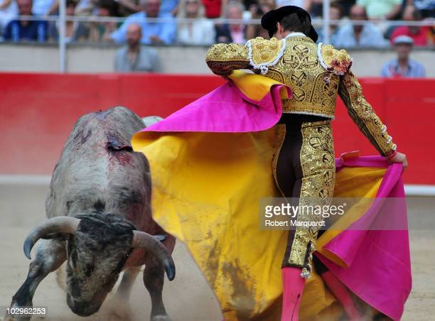 Bullfighter Julian Lopez 'El Juli' performs in the bullfighting ring at the Monumental on July 18 2010 in Barcelona Spain