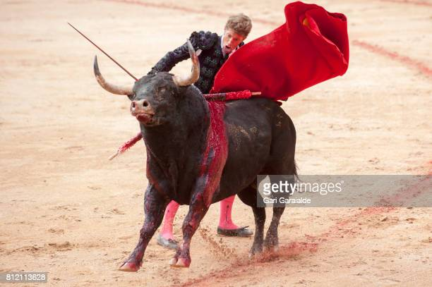 Bullfighter Manuel Escribano performs during a bullfight as part of the fifth day of the San Fermin Running of The Bulls festival on July 10 2017 in...