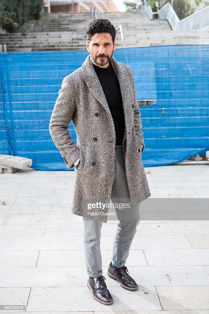 Bullfighter Oscar Higares wears Martinelli shoes, Socketines socks, H&M trousers and pullover Adolfo Dominguez jacket, Zara coat and Briston watch on January 22, 2017 in Madrid, Spain.