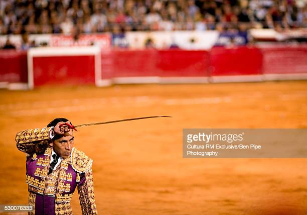 Bullfighter poised with sword, Plaza Mexico, Mexico City, Mexico