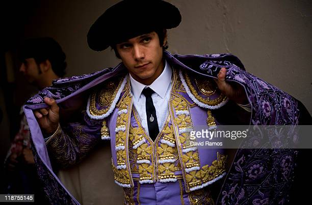 Bullfighter Sebastian Castella of France dresses up before the second bullfight of the 2011 season at the Monumental bullring on July 10 2011 in...