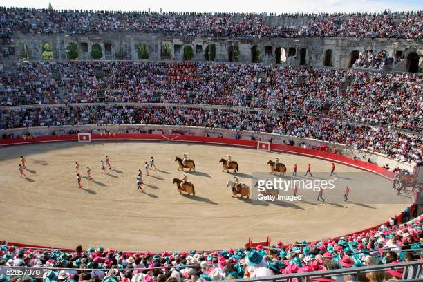 Bullfighters parade around the Antic Bullring prior to the last bullfight, during the Feria of Pentecost May 16, 2005 in Nimes, France. The feria...