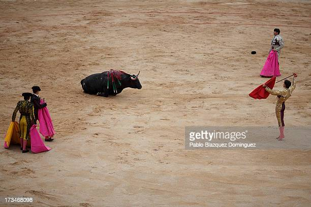 Bullfighters perform with a Miura's fighting bulls at the bullring on the ninth day of the San Fermin Running Of The Bulls festival on July 14 2013...