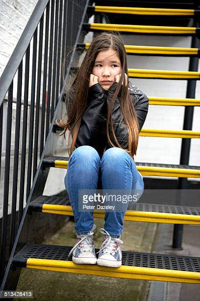 Bullied teenager on steps