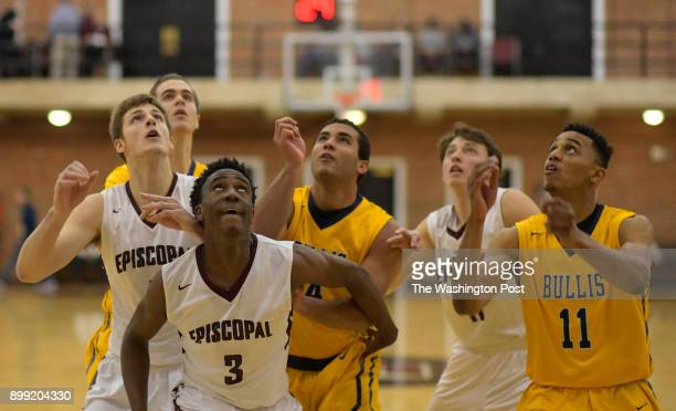 Bullis and Episcopal player gather for a rebound during Episcopals defeat of Bullis 64 62 in boys basketball at Episcopal High School in Alexandria...