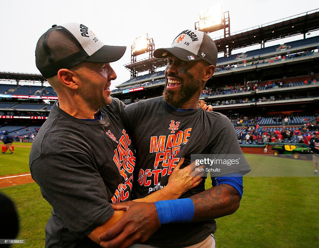 Bullpen catcher 2Dave Racaniello #53 and Jose Reyes #7 of the New York Mets celebrate after defeating the Philadelphia Phillies 5-3 during a game at Citizens Bank Park on October 1, 2016 in Philadelphia, Pennsylvania. The win clinched a Wild Card game for the Mets.