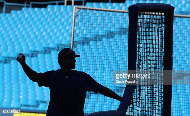 TORONTO ON SEPTEMBER 12 Bullpen Catcher Jason Phillips throws batting practice as the Toronto Blue Jays play the Tampa Bay Rays in Toronto September...