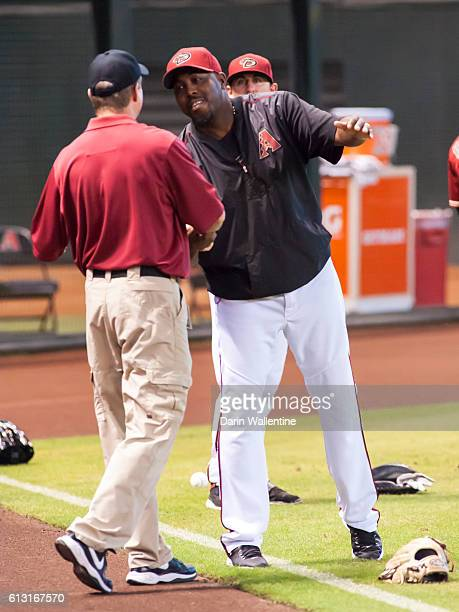 Bullpen coach Garvin Alston of the Arizona Diamondbacks greets an Arizona Diamondbacks staff member before the MLB game against the San Diego Padres...