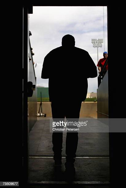 Bullpen coach Jim Slaton of the Seattle Mariners walks out onto the field before the MLB spring training game against the Texas Rangers on March 6...