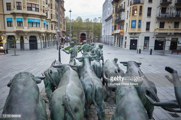 Bullring is seen behing the monument to San Fermin at Carlos III Avenue on the 33rd day of the state of emergency and three days after nonessential...