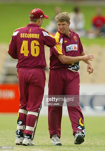 Bulls bowler James Hopes is congratulated by keeper Wade Seccombe after he bowled Graham Manou for 46 in the ING Cup match between the Southern...