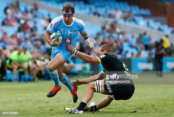 Bulls' captain Burger Odendaal tackles Hurricanes' captain Brad Shields during the SUPER XV Rugby match between Bulls and Hurricanes at Loftus Rugby...
