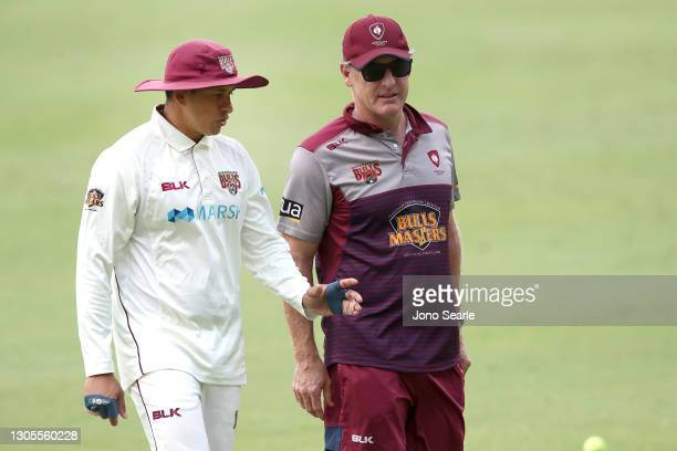 Bulls captain Usman Khawaja and coach Wade Seccombe speak before day one of the Sheffield Shield match between Queensland and Western Australia at...