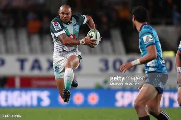 Bulls' Cornal Hendricks runs with the ball during the Super Rugby match between New Zealand's Auckland Blues and South Africa's Northern Bulls at...