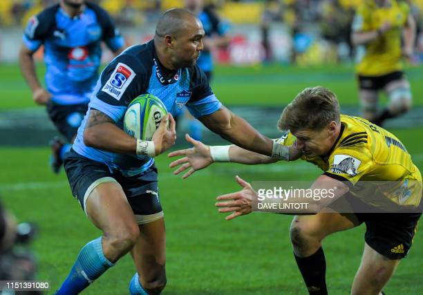 Bulls Cornal Hendricks tries to evade a tackle from Hurricanes' Jordie Barrett during the Super Rugby match between New Zealand's Hurricanes and...