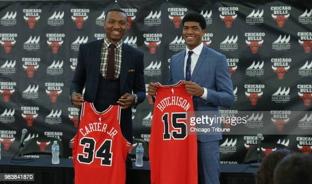 Bulls draft picks Wendell Carter Jr left and Chandler Hutchison pose with their jerseys on Monday June 25 at the Advocate Center in Chicago