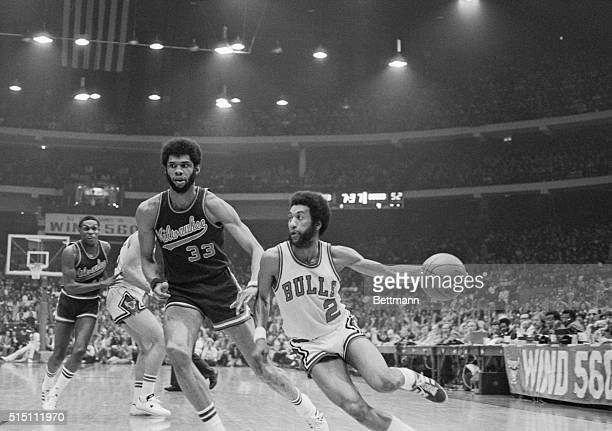 Bulls guard Norm Van Lier drives past Bucks center Kareem Abdul-Jabbar during Game 2 of the NBA Playoffs at the United Center in Chicago....
