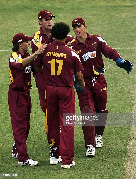 Bulls keeper Wade Seccombe congratulates Andrew Symonds after taking the wicket of Graham Manou of the Redbacks during the ING Cup match between the...
