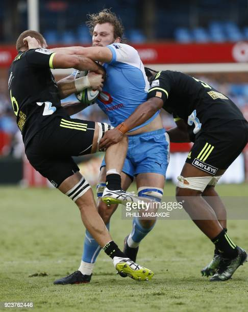 Bulls' RG Snyman vies with Hurricanes' captain Brad Shields and Sam Lousi during the SUPER XV Rugby match between Bulls and Hurricanes at Loftus...