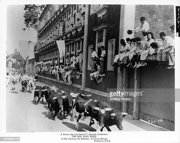 Bulls run down the street in a scene from the film 'The Sun Also Rises' 1957