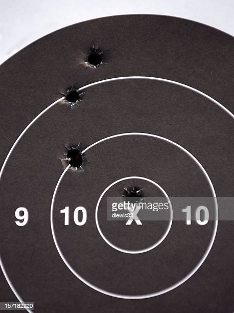 bullseye - bullet hole stock pictures, royalty-free photos & images