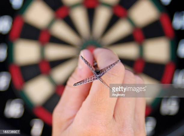 bullseye - darts stock pictures, royalty-free photos & images