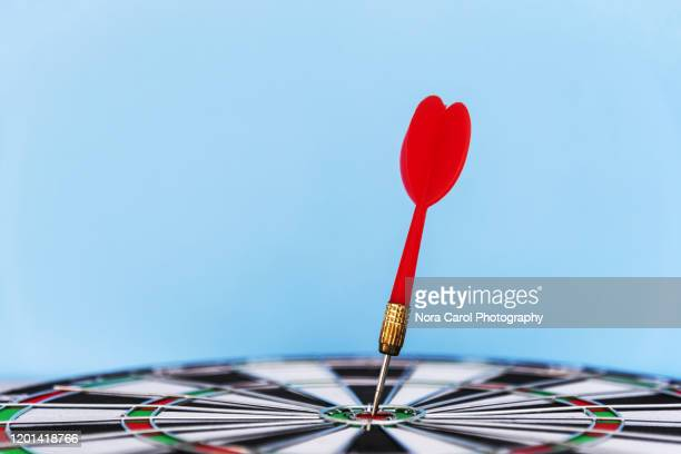bullseye with dart success concept - sports target stock pictures, royalty-free photos & images