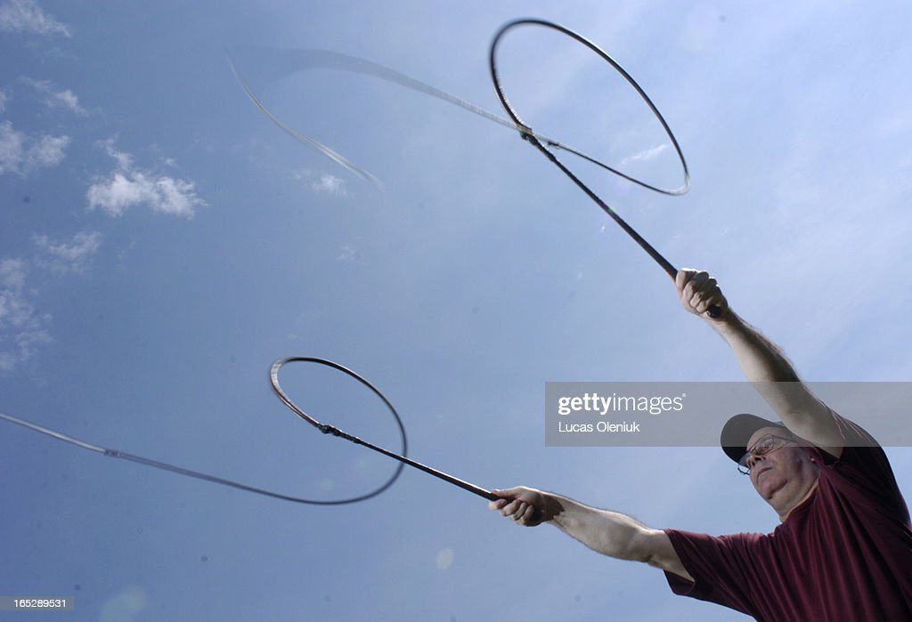 Bullwhip expert, Gerry Comeau, demonstrates a double coachman's crack with a pair of bullwhip's. : News Photo