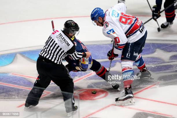 Bully between Keith Aucoin of Red Bull Munich and Luke Adam of Adler Mannheim during the 38th game day of the German Ice Hockey League between Red...