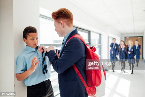 bullying in the corridor - witness stock pictures, royalty-free photos & images