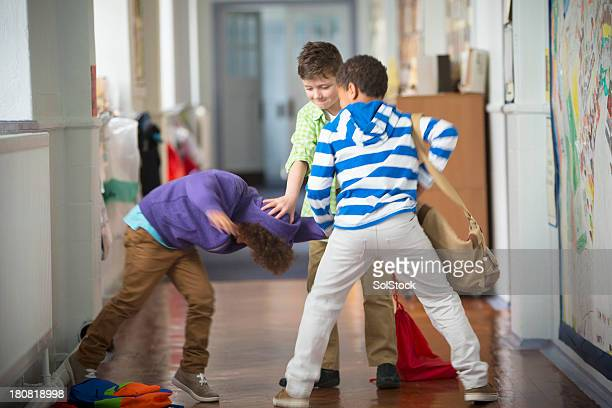 bullying in the school corridor - school building stock pictures, royalty-free photos & images