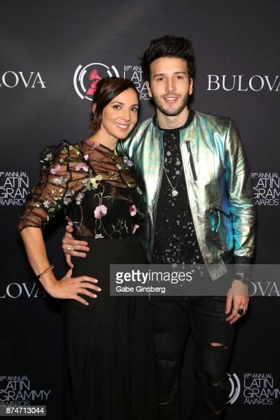 Bulova brand representative Yuri Ayala and Sebastian Yatra attend the gift lounge during the 18th annual Latin Grammy Awards at MGM Grand Garden...