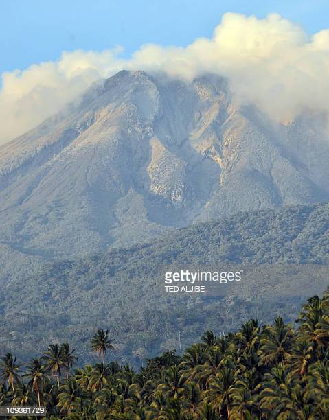 Bulusan volcano is seen from the town of Irosin Sorsogon province south of Manila on February 23 days after the volcano spewed ash into the air...