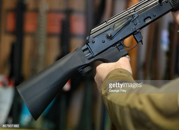 A bump stock device that fits on a semiautomatic rifle to increase the firing speed making it similar to a fully automatic rifle is installed on a...