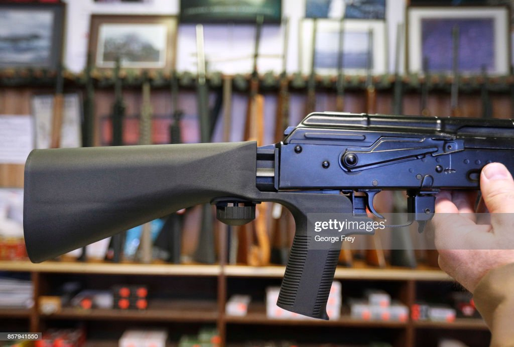 A bump stock device (left) that fits on a semi-automatic rifle to increase the firing speed, making it similar to a fully automatic rifle, is installed on a AK-47 semi-automatic rifle, (right) at a gun store on October 5, 2017 in Salt Lake City, Utah. Congress is talking about banning this device after it was reported to of been used in the Las Vegas shootings on October 1, 2017.