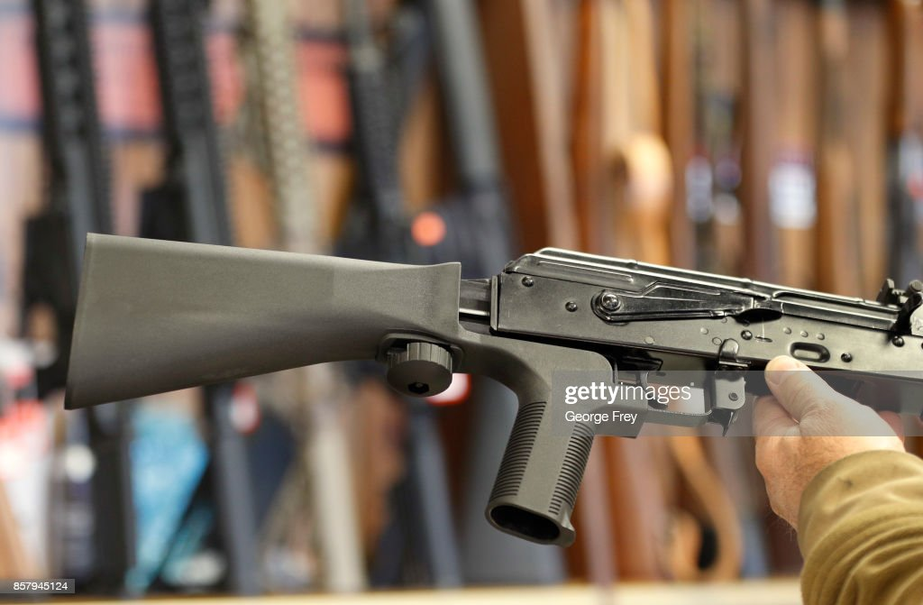 A bump stock device, (left) that fits on a semi-automatic rifle to increase the firing speed, making it similar to a fully automatic rifle, is installed on a AK-47 semi-automatic rifle, (right) at a gun store on October 5, 2017 in Salt Lake City, Utah. Congress is talking about banning this device after it was reported to of been used in the Las Vegas shootings on October 1, 2017.