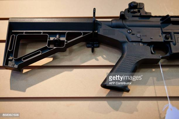 Bump stock installed on an AR-15 rifle is viewed at Blue Ridge Arsenal in Chantilly, Virgina, on October 6, 2017. / AFP PHOTO / JIM WATSON