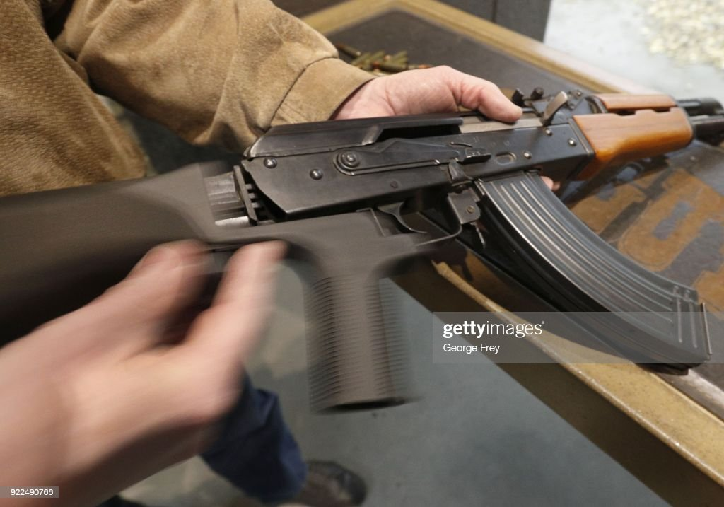 A bump stock is installed on an AK-47 and its movement is demonstrated at Good Guys Gun and Range on February 21, 2018 in Orem, Utah. The bump stock is a device when installed allows a semi-automatic to fire at a rapid rate much like a fully automatic gun.