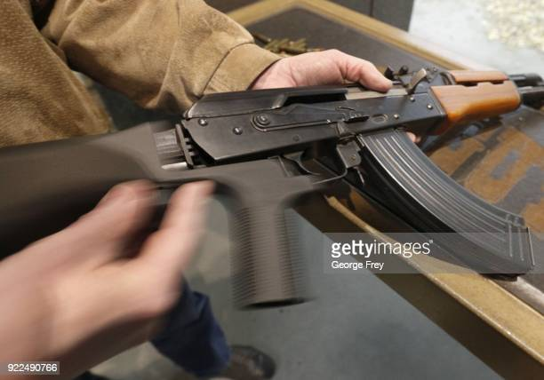 A bump stock is installed on an AK47 and its movement is demonstrated at Good Guys Gun and Range on February 21 2018 in Orem Utah The bump stock is a...