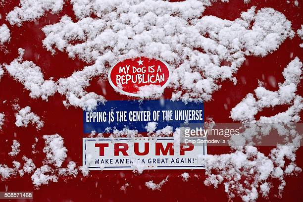 A bumper sticker for Republican presidential candidate Donald Trump is dusted with snow outside the Londonderry Lions Club where the billionaire was...