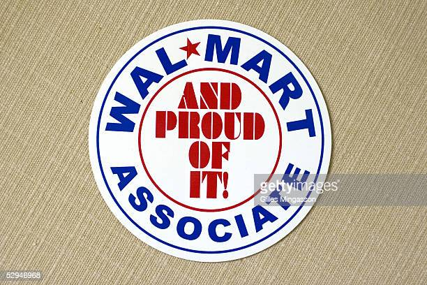 A bumper sticker WalMart Associate and Proud of It part of WalMart's efforts to create a positive image it is for sale at the WalMart museum March 17...