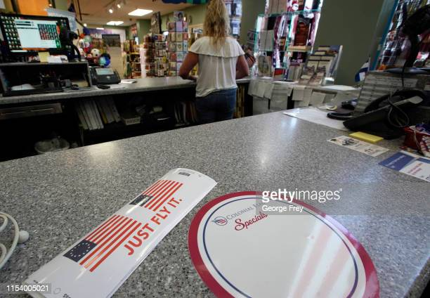 Bumper stickers with Just Fly It with the Betsy Ross flag, sit on the counter for sale at Colonial Flag on July 5, 2019 in Salt Lake City, Utah. The...