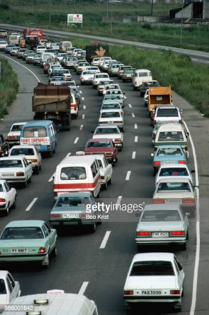 bumper to bumper traffic on port of spain highway - port of spain stock pictures, royalty-free photos & images
