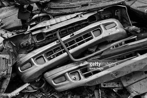 Bumpers from high polluting vehicles taken off the road by authorities are seen piled up at an auto scrapyard on September 25 2015 in Zhejiang China...