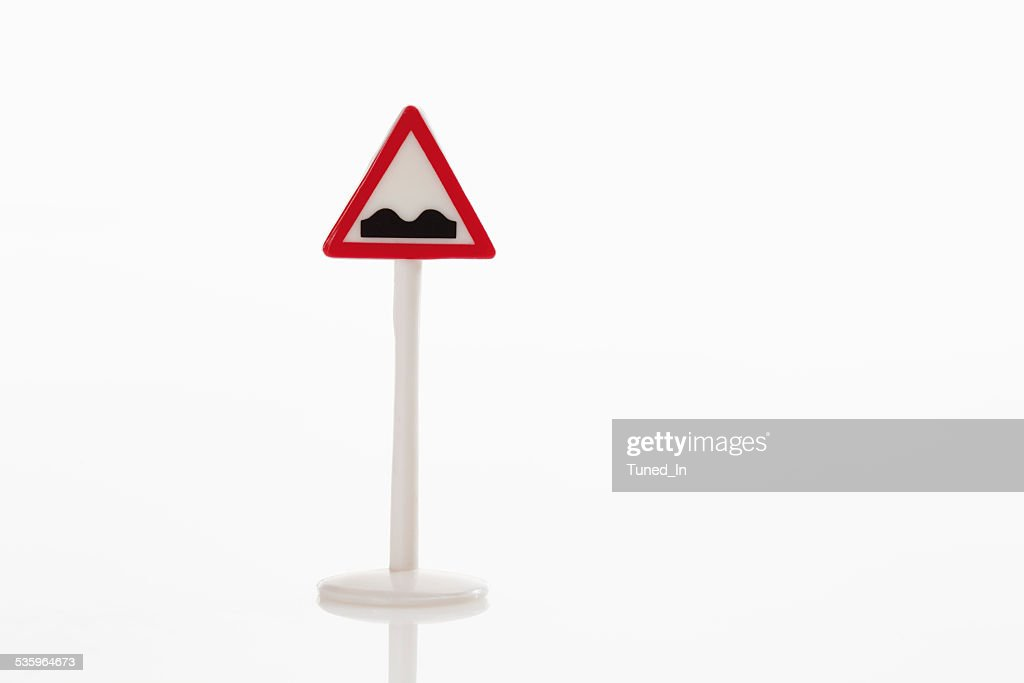 Bumps ahead sign on white background : Stock Photo
